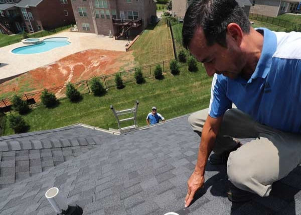 Knoxville Engineered Home Inspections Bert on Roof pointing out defect