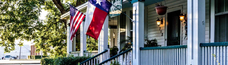 Texas and US Flag on House