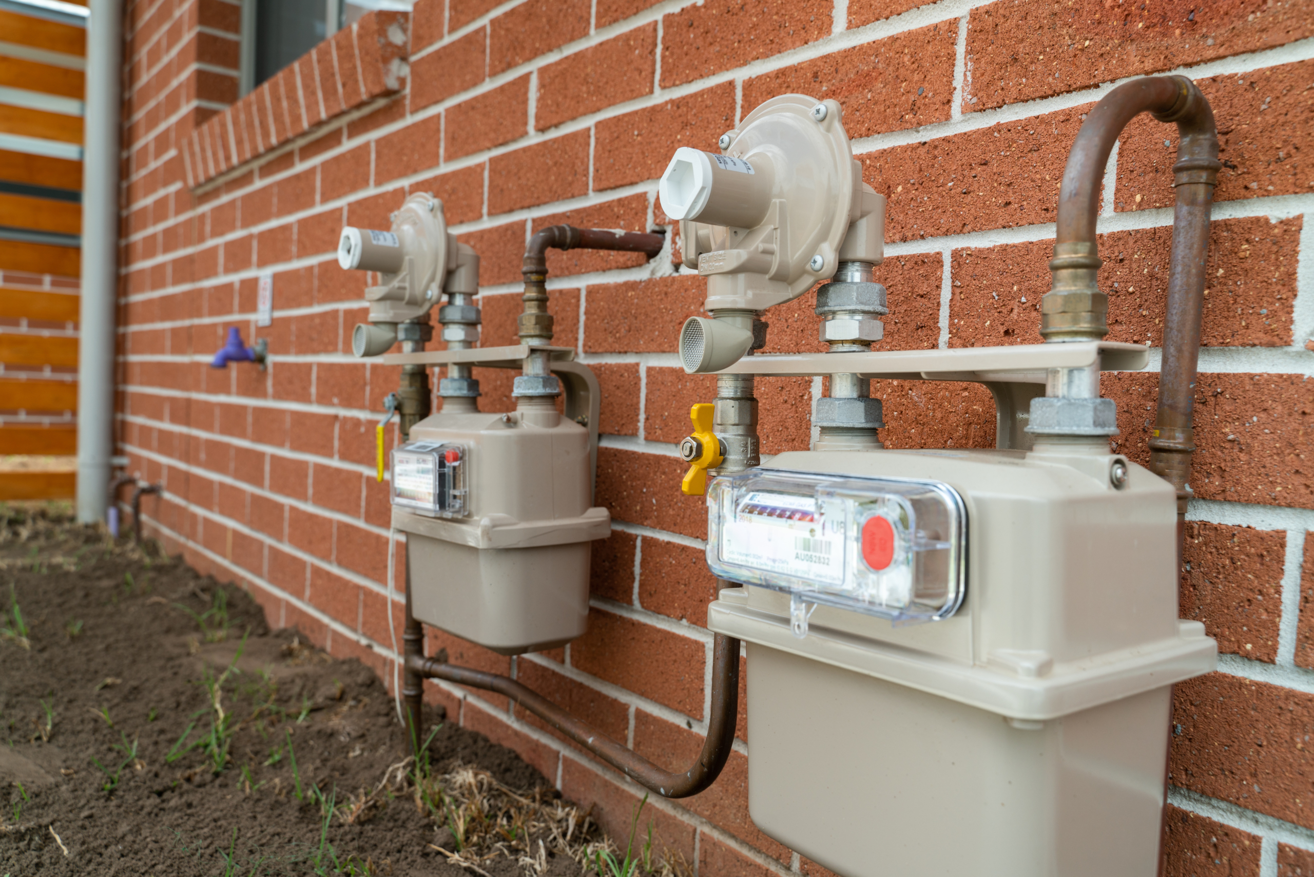 House Gas Meters outside of a residential house in New South Wales, Australia