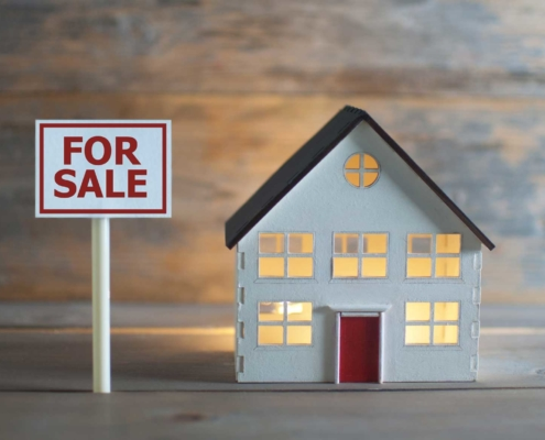 Doll house with for sale sign